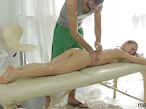 After giving BJ by way of massage babe with juicy ass Sabrina Moore rides Hawkshaw
