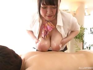 Chubby Japanese secretary Mochida Yukari oils up her tits for a titjob