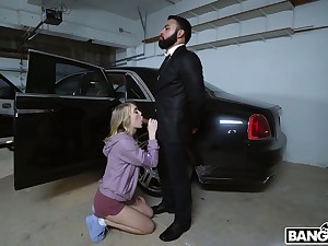 Blond babe Anastasia Manful gives a blowjob in the parking lot before crazy sex