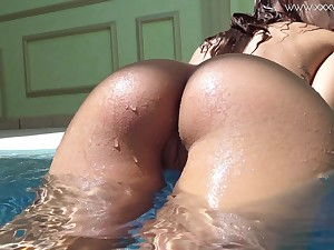 Bootyfull babe swimming coupled with getting some vitamin D